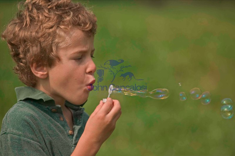 Boy blowing bubbles - Pennsylvannia - USA