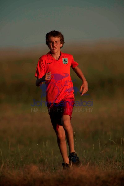 Boy running - model released - South Dakota - USA
