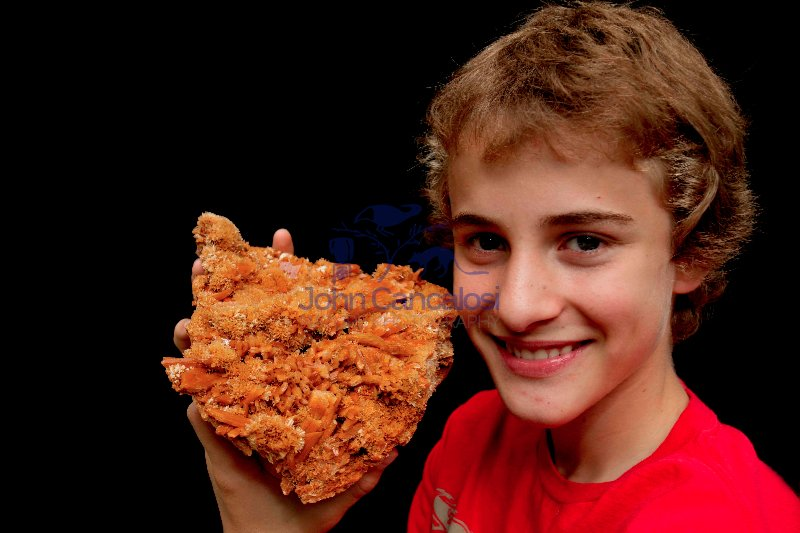 Boy holding Selenite specimen - New York - USA - Model released