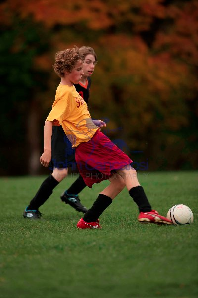 Boy playing soccer (football) - New York - USA- Model released(b