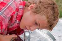 Boy - Age 11 - Drinking from Drinking Fountain - USA