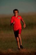 Boy running - model released - South Dakota - USA
