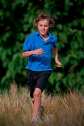 Boy Running in Field -  England - UK