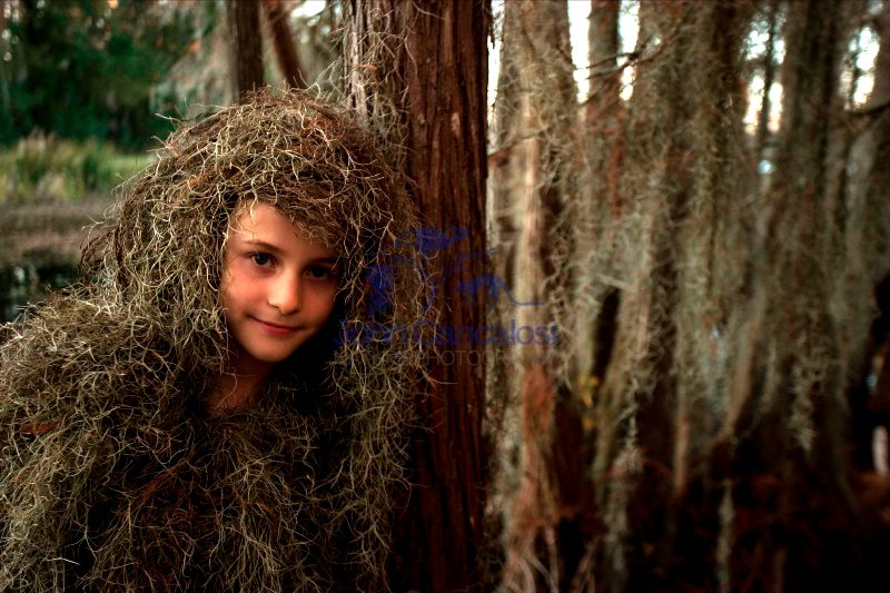 Child in Swamp With Spanish Moss  - Louisiana USA
