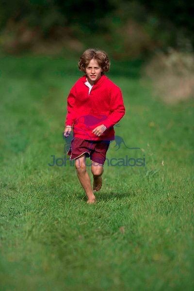Boy Running in Grass Lane -  England - UK